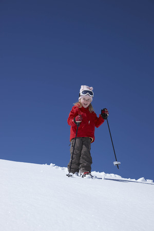 snows: Little girl skiing on mountain LANG_EVOIMAGES