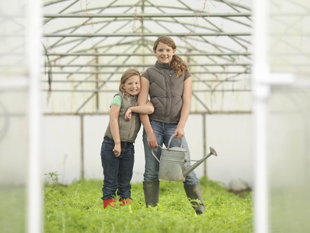 conservatories: Sisters With Watering Can In Polytunnel