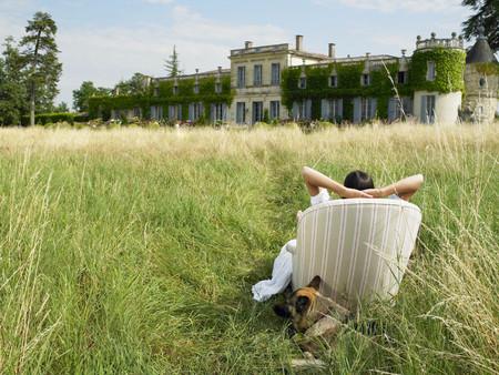 lavish: Woman on sofa in a field,  castle view