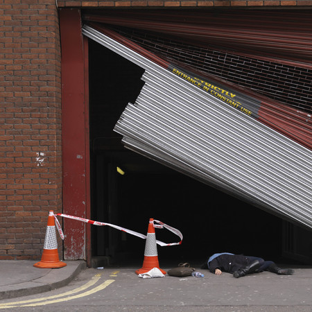 adverse: Woman lying underneath broken shutter