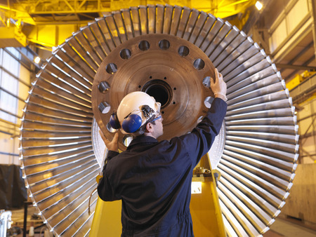 commerce and industry: Engineer Inspecting Turbine