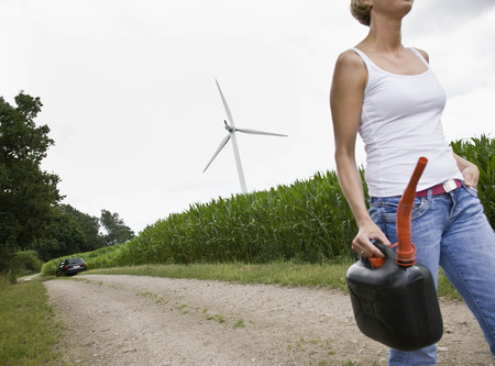Woman walking with a gas can