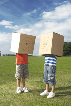 timidity: boys with boxes over heads LANG_EVOIMAGES