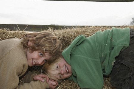 mischeif: Two boys on hay bales
