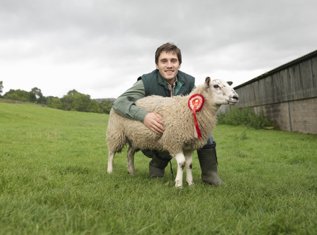 prevailing: Farmer With Prize-Winning Sheep LANG_EVOIMAGES