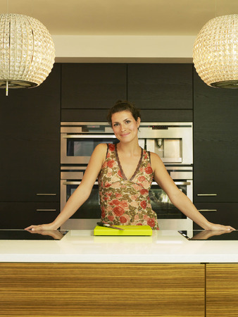 worktops: Woman leaning on kitchen work top