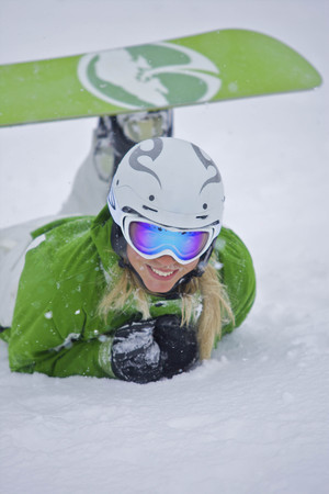joyous: Snowboarder lying in the snow