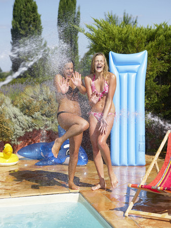 saturating: Girls watered on the side of the pool