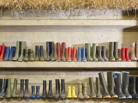 messy clothes: Wellington Boots Against The Wall