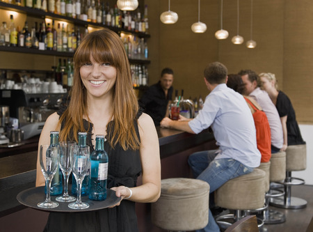 Waitress holding tray of drinks LANG_EVOIMAGES