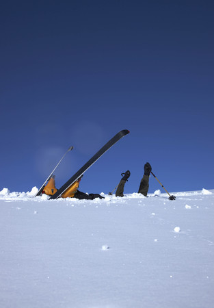 jeopardizing: Skier head down in snow