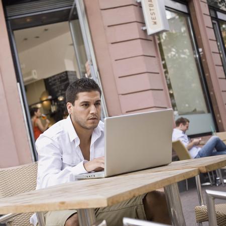 telecommuter: Man outside on laptop