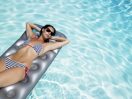 Woman enjoying the sun on air mattress