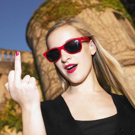tilting: Blond woman giving the finger