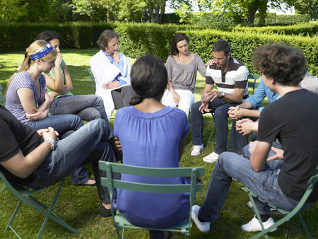 round chairs: Circle of people in rehab,  outdoors