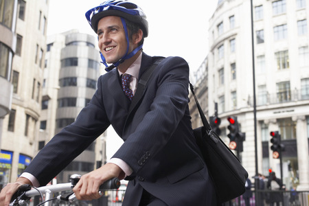 Business man on a bicycle LANG_EVOIMAGES