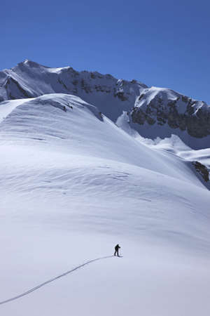 winter escape: Skier in mountain landscape