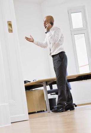pleading: Man talking on telephone