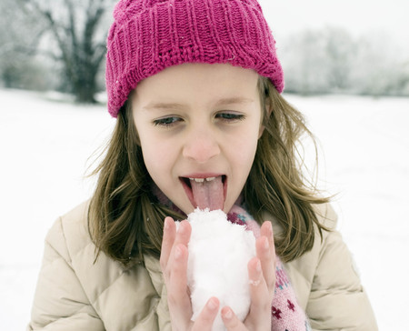 savour: Girl tasting snow ball LANG_EVOIMAGES