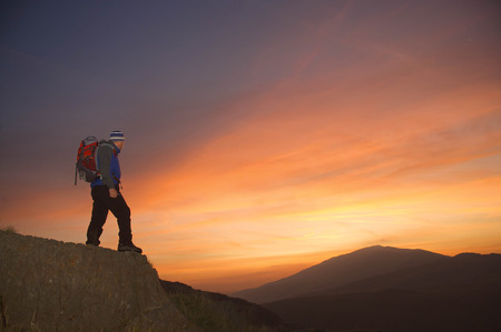 Hiker looking at the sunrise.