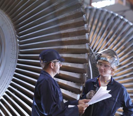 interrogations: Engineers Next To Turbine