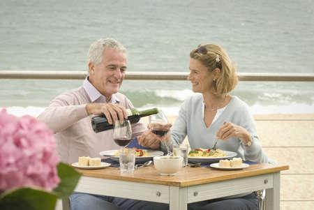 munching: Couple dining at seaside restaurant