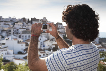 Man taking picture of view