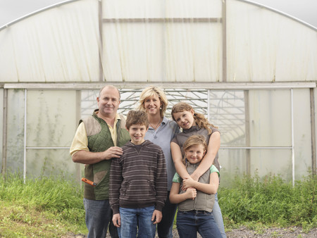 conservatories: Farmer And Family Outside Polytunnel LANG_EVOIMAGES
