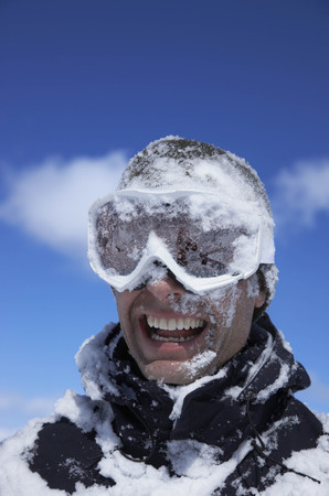 Man laughing,  face covered with snow
