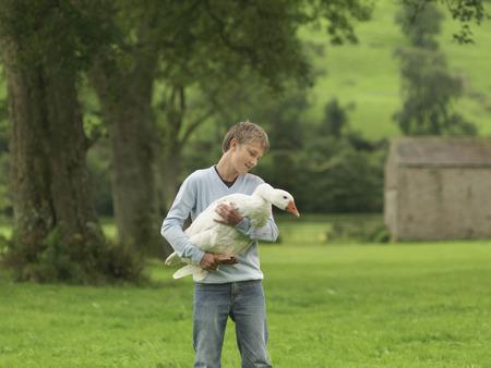 Boy Holding Goose