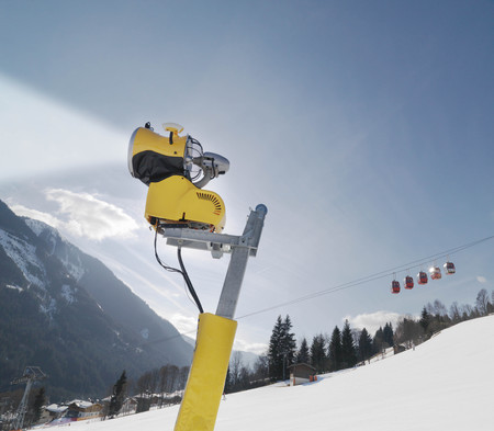 sprayed: Snowblower and cable car in ski resort LANG_EVOIMAGES