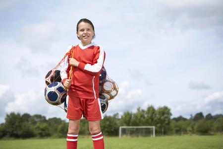 obligations: Footballer with bag of balls LANG_EVOIMAGES