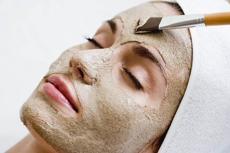 dirtied: Woman getting face mask