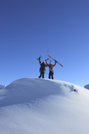 Skiers on top of mountain LANG_EVOIMAGES