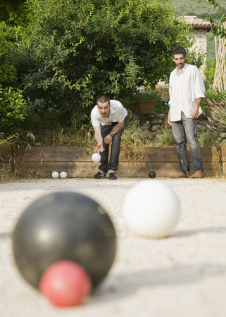 bocce: Two men playing bocce ball