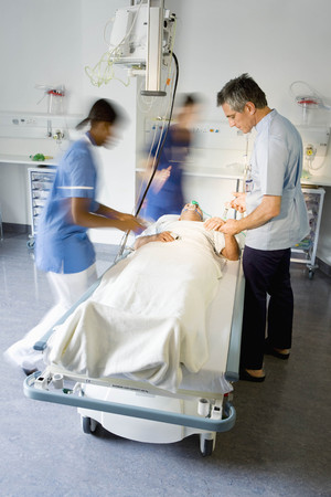 A doctor helping a patient in hospital