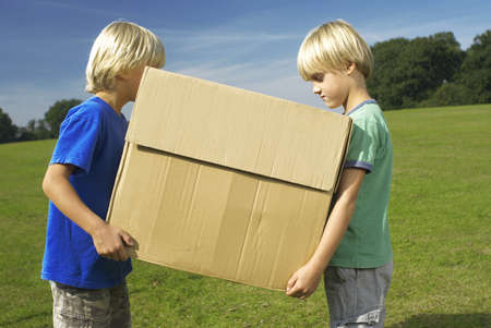 equivalents: two boys holding box