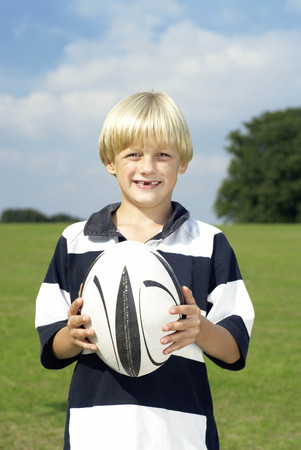 young boy with rugby ball LANG_EVOIMAGES