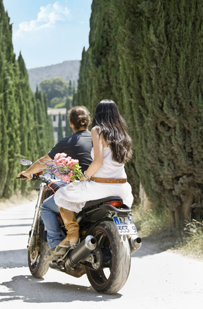 Man and woman riding on a motorcycle