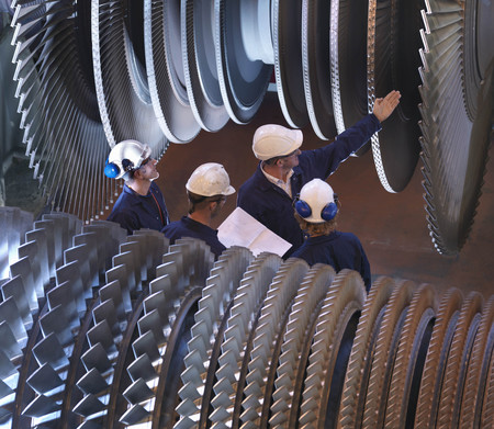 interrogations: Group Of Engineers With Turbines