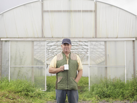 conservatories: Farmer With Mug Outside Polytunnel