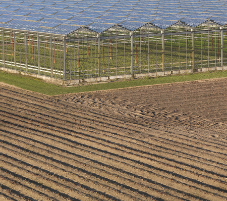 conservatories: Greenhouses in ploughed field LANG_EVOIMAGES