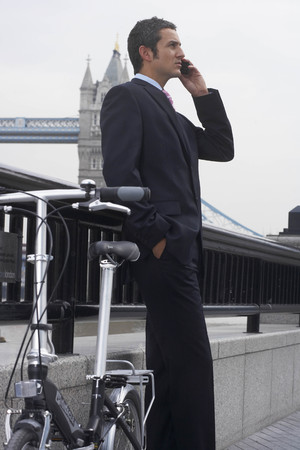 somber: Business man using a mobile phone
