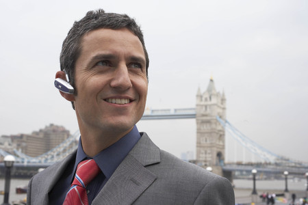 handsfree telephones: Man with bluetooth headset outside