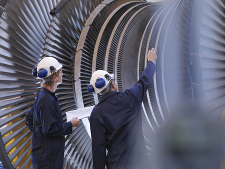 taught man: Engineers Looking At Turbine LANG_EVOIMAGES