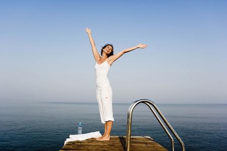Woman having fun on a pier