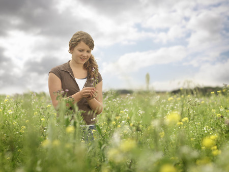 assembled: Girl In Field With Flowers LANG_EVOIMAGES