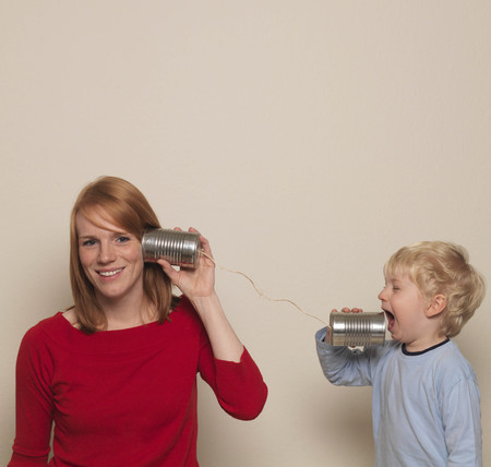 shrieking: Mother and son playing with can phone