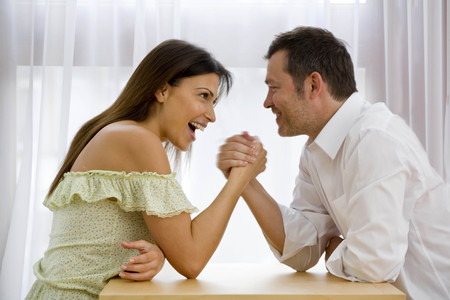 aggressively: Man and Woman arm wresting