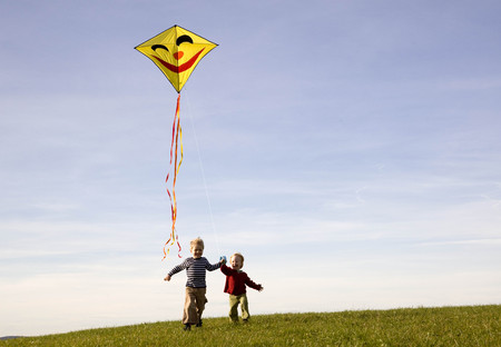 Two Boys fly a Kite LANG_EVOIMAGES